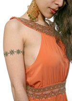 Bollywood bindi styles! Fancy crystal bindi, belly bindi, arm tattoos, and more bindis