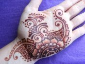 Henna tattoo at full full color in deep red brown henna stain