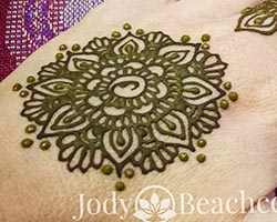 Mandala henna design with fresh henna paste
