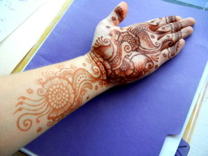 Henna stains darkest on the palms and gets lighter the further away you get.
