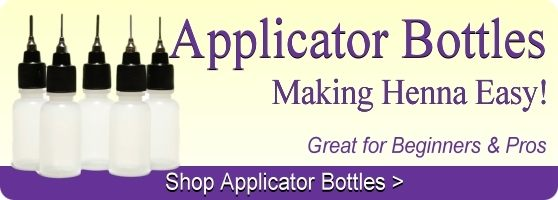 Henna applicator bottles with metal tips.