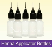 Plastic applicator bottles for dispensing henna paste and other liquids.